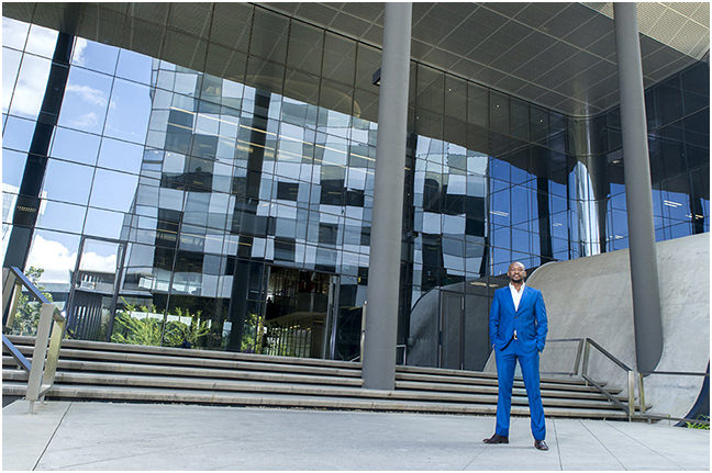 CEO of ABSA Wealth outside building in Sandton