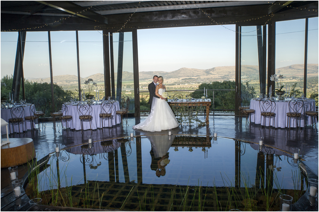 Bride on a jetty with trout dam at Oxbow Country Estate
